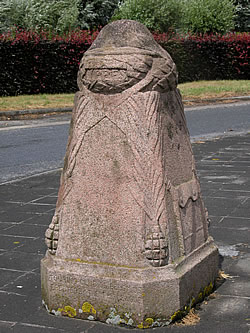Demarcation Stone No. 16 at Zillebeke, south-east of Ypres in Belgium with a British helmet on the top.