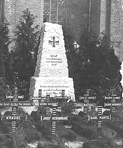 German graves and memorial from 1915 in a church graveyard in the Flanders battlefields of the Ypres Salient.