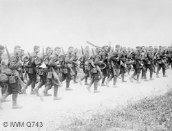 Soldiers of the 10th Battalion, East Yorkshire Regiment marching to the trenches near Doullens, 3 July 1916. (IWMQ743)