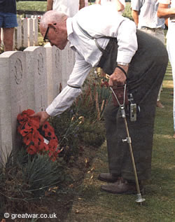 WW1 veteran Tom Price lays a poppy wreath.
