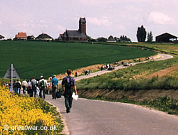 Guided walking tour on the Somme battlefield, walking towards Thiepval church.