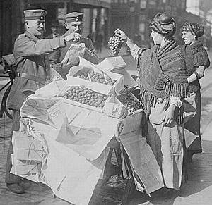 German troops in Belgium buying fruit in Belgium, autumn 1914.