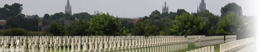 French military graves at Saint Charles de Potyze cemetery on the Ypres Salient battlefields. The spires of Ypres- Ieper are seen in the background.